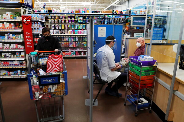 A pharmacist preparing to administer a dose of the Moderna vaccine at a Walmart in West Haven, Conn. Walmart, the nation's largest private employer, is offering electronic verification apps to patients vaccinated in its stores.