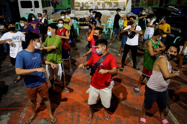 People accused of breaking coronavirus rules were made to exercise as punishment in Manila last month.