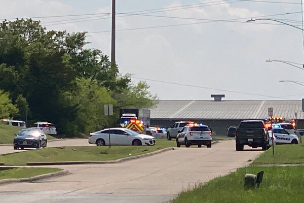 The police responded in force to the Brazos County Industrial Park in Bryan, Texas, on Thursday after a shooting at a cabinet company headquarters.