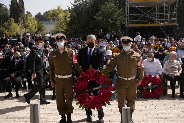 Prime Minister Benjamin Netanyahu of Israel prepares to lay a wreath at Yad Vashem Holocaust Memorial in Jerusalem on Thursday.