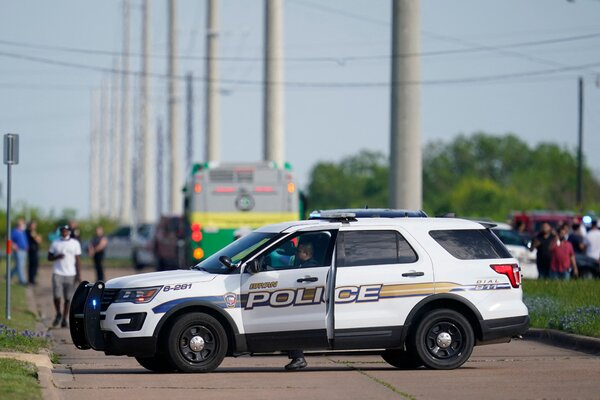 Police officers directed workers from the scene of a shooting at Kent Moore Cabinets on Thursday.