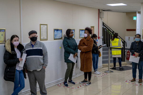 People wait for their vaccines at Brent Central Mosque in London earlier this month.