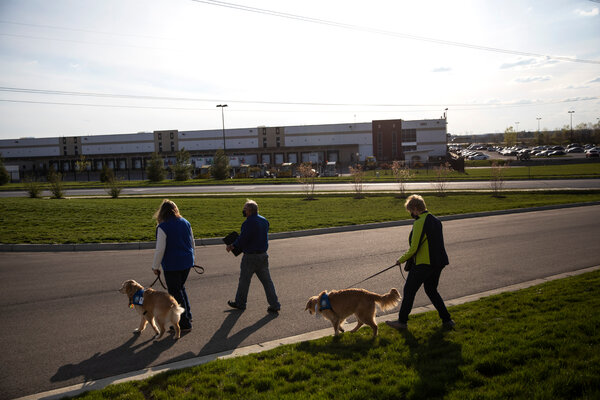 Comfort dogs and their trainers arriving at the site of the mass shooting in Indianapolis on Friday.