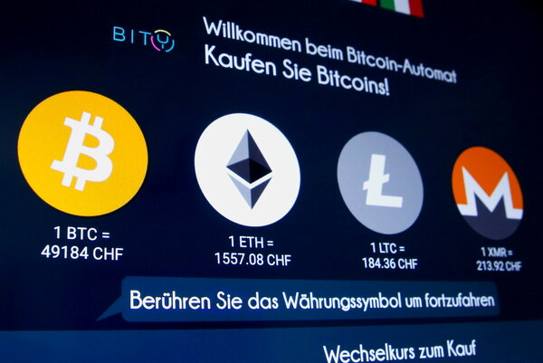 The display at a crytocurrency ATM in Zurich, Switzerland. Prices of cryptocurrencies and related stocks slipped lower on Tuesday.