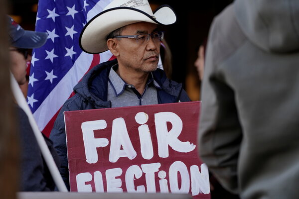Protesters gathered in Phoenix in December as Arizona electors cast their votes for the presidential election.