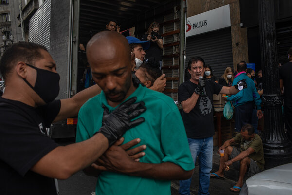 Members of the Frutos do Senhor evangelical church performing baptisms and serving breakfast to homeless people in São Paulo, Brazil, this month.