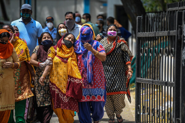 Relatives mourning outside a hospital mortuary in Delhi after seeing bodies of Covid-19 victims on Friday.