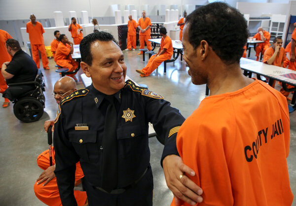 Sheriff Ed Gonzalez of Harris County, Texas, spoke with an inmate at the Harris County Joint Processing Center in 2019. President Biden plans to nominate Mr. Gonzalez to head Immigration and Customs Enforcement.