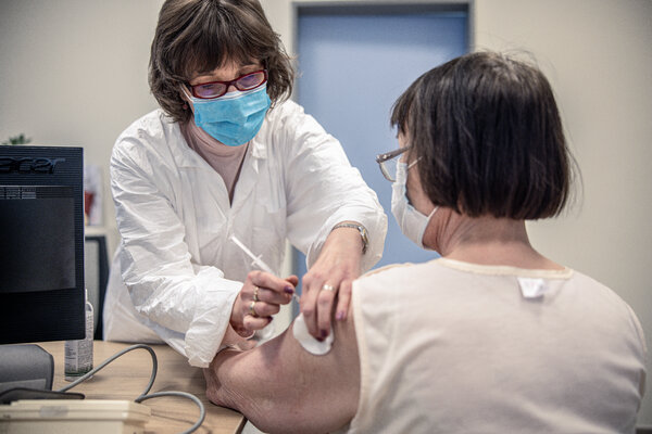 Receiving the AstraZeneca vaccine in Budapest.
