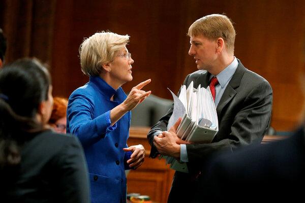 U.S. Senator Elizabeth Warren with Richard Cordray after he testified about Wall Street reform before a Senate Banking Committee in 2014.