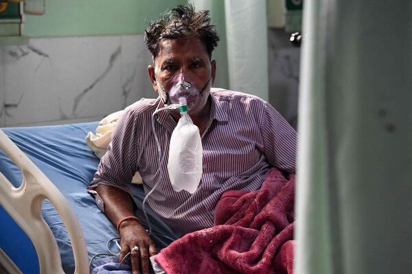 A Covid-19 patient at a hospital in Moradabad, India, on Wednesday.