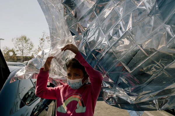 Melissa with a Mylar blanket from a migrant center in Donna, Texas, where she spent days inside.