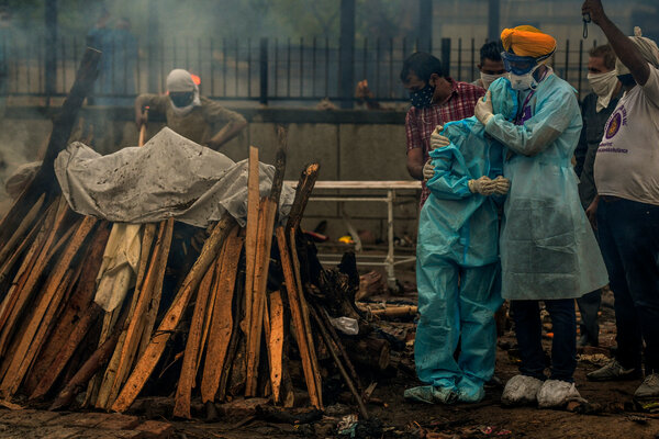 Jitender Singh Shunty, right, whose organization runs the Seemapuri cremation grounds in New Delhi, said that about 100 bodies arrived every day.