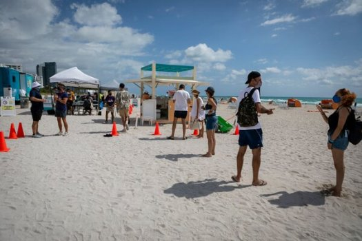 A pop-up vaccination site in Miami Beach, Fla. Companies are debating vaccine mandates for their workers.