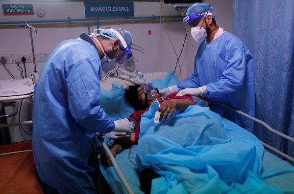 Medical workers tending to acoronavirus patient in an emergency room in New Delhi last week.