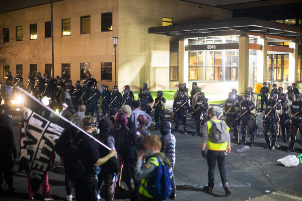 A crowd confronting the Brooklyn Center police department on Sunday night.