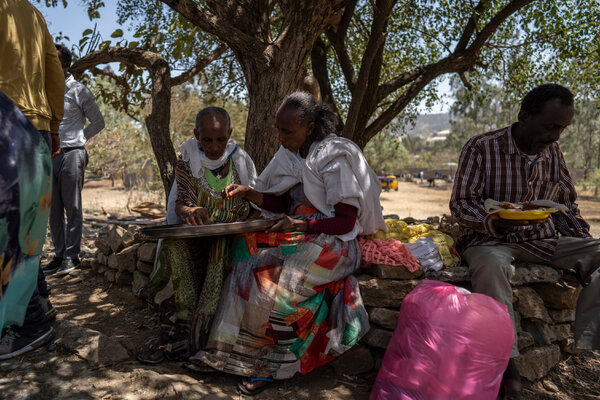 Refugees eating at a makeshift camp at a secondary school for internally displaced people in Mekelle, the capital of Tigray, in March.
