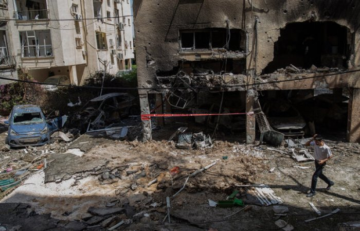 A building that was hit by a rocket fired from the Gaza Strip overnight in Petah Tikva, Israel, on Thursday.