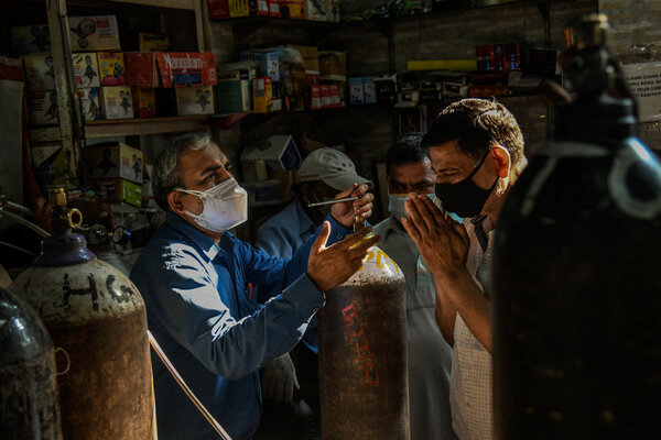 A man pleaded for his oxygen cylinder to be refilled at a local shop in Delhi earlier this month.