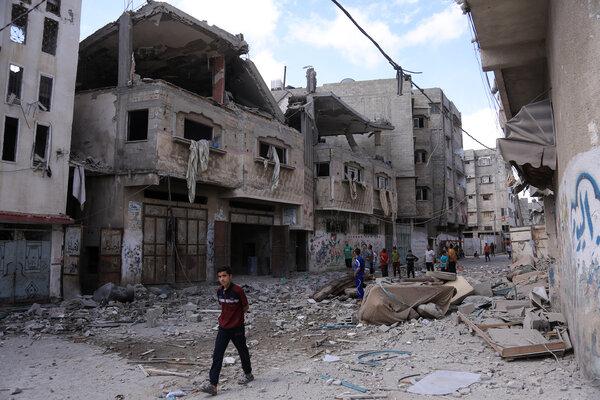 Surveying damage in Gaza on Monday after Israeli bombardments.