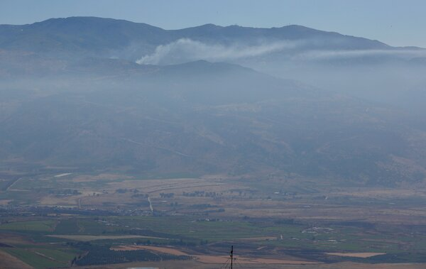 Smoke billowing from a Lebanese border village on Tuesday, after overnight Israeli shelling. The Israeli military said the strikes were in response tomilitants' efforts to fire rockets into Israel.