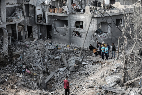 Gaza residents surveying the damage to their homes on Friday.