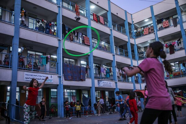 Palestinian children and their families took refuge at a U.N. school in Gaza City on Wednesday.The United Nations has warned of a potential virus surge as tens of thousands of Gazans took shelter in U.N. schools.