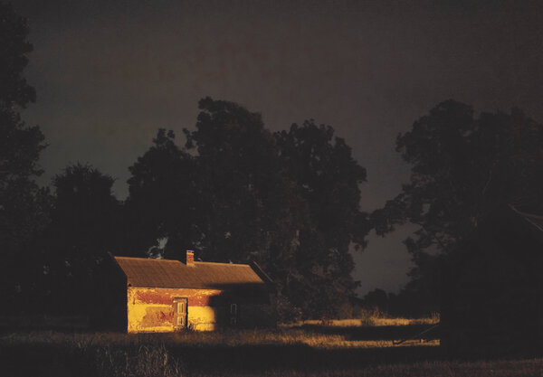 """""""Decision to Leave,"""" a photograph from Jeanine Michna-Bales's """"Through Darkness to Light: Photographs of the Underground Railroad,"""" 2013."""
