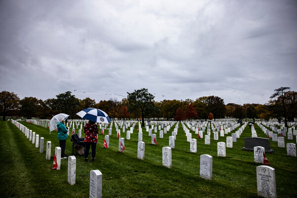 Visiting a grave at Arlington National Cemetery on Veterans Day in November.