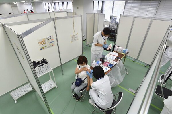 Administering a coronavirus vaccine at a center in Osaka, Japan, on Monday.