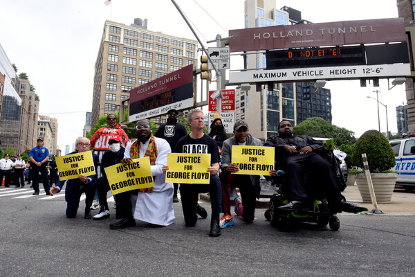 A small group of Black Lives Matter demonstrators in Manhattan blocked traffic through the Holland Tunnel on the one-year anniversary of George Floyd's death.