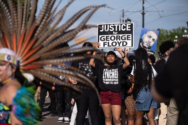Protesters march with members from the organization, Families Supporting Families Against Police Violence in St. Paul, Minn., last night. Marches and gatherings are planned throughout the day.