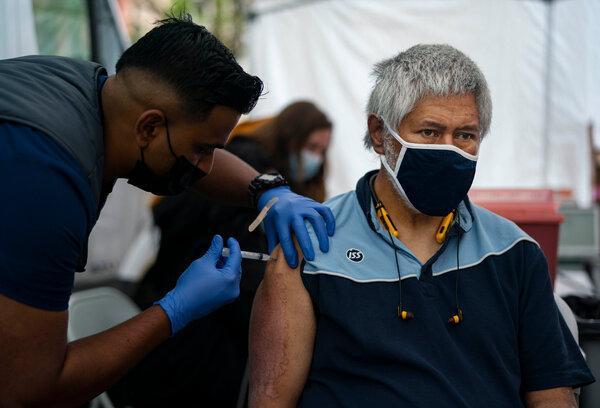 Receiving a vaccine dose in Seattle last week.