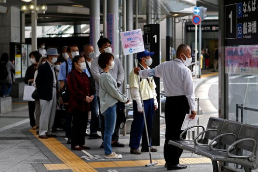 Lining up to take a shuttle bus to a vaccination center in Osaka, Japan, on Friday.