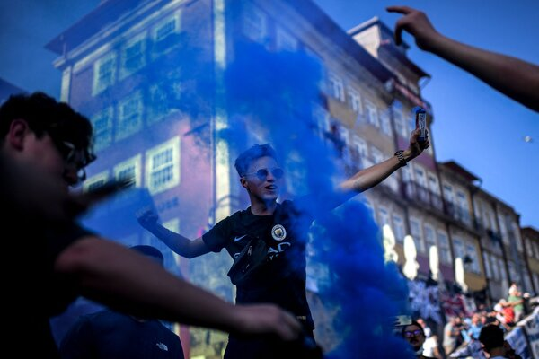 City fans with smoke in Chelsea's preferred shade of blue.