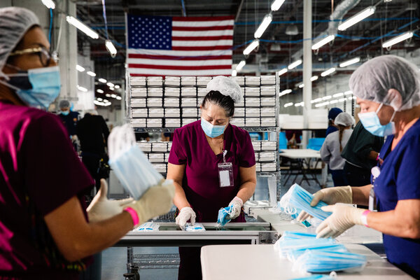 Employees at DemeTech, a Florida company that this month laid off 1,500 workers who made surgical masks. U.S. manufacturers have seen a calamitous drop in sales.