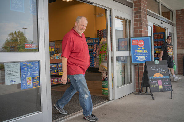 At a Kroger supermarket in Yorktown, Va. Some customers stopped wearing masks after employers removed requirements to do so.