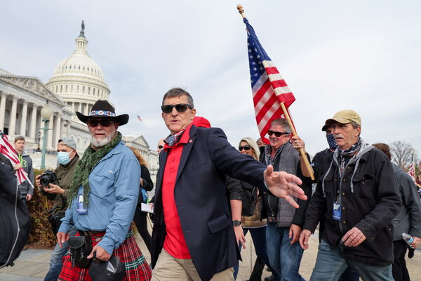 Michael T. Flynn, center, at a Dec. 12 rally in Washington to protest the presidential election results.
