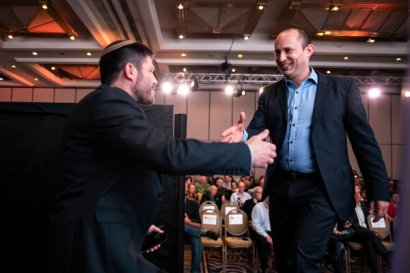 Naftali Bennett, right, at an election campaign event in 2019.