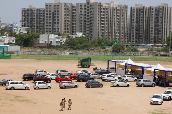 A line at a drive-in vaccination center in Ahmedabad, India, on Friday.