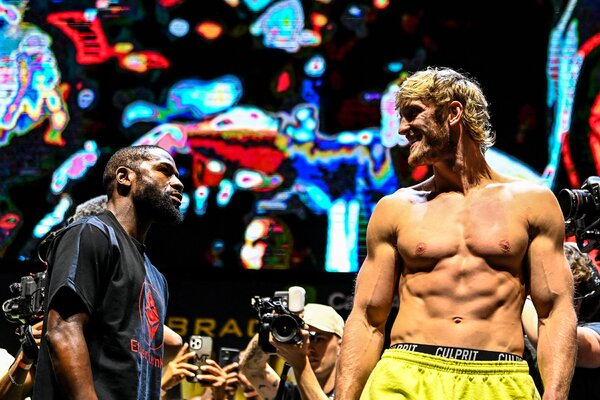Paul, right, outweighed Mayweather by nearly 35 pounds on Saturday.