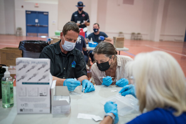 A Covid vaccine clinic in Bernalillo, N.M. The vaccine is free, but polls show that about a third of unvaccinated adults were unsure whether insurance covered it.