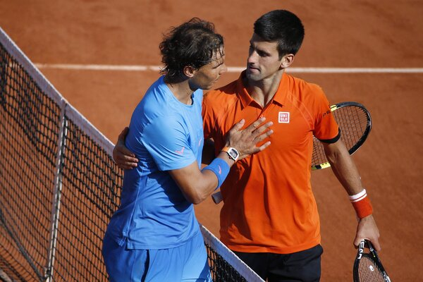 Nadal, left, shook hands with Djokovic after beating him easily to win the 2020 French Open.