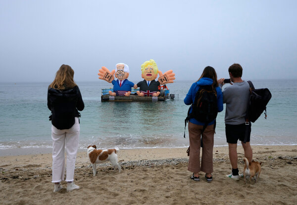 Floating balloons caricaturing President Biden and Prime Minister Boris Johnson of Britain in the harbor of Falmouth, England, on Friday.