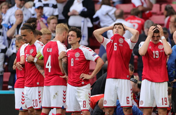 Danish players and staff members formed a circle to shield the medics working on Christian Eriksen.