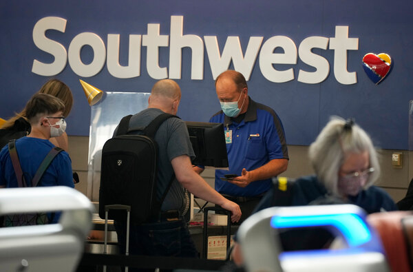 The Southwest Airlines check-in counter at Denver International Airport on Wednesday.About half of Southwest's scheduled flights on Tuesday and Wednesday were delayed.