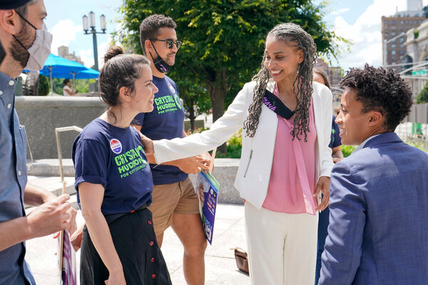 New York City mayoral candidate Maya Wiley, second from right, talks to supporters after a news conference on Tuesday, in Brooklyn, New York.