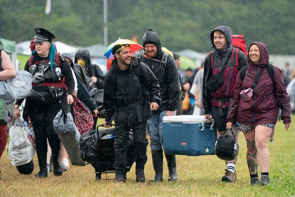 Festivalgoers at the Download Festival in Donington Park, England, last Friday. The three-day festival is a test event to examine how Covid-19 transmission takes place in crowds, with reduced capacity.