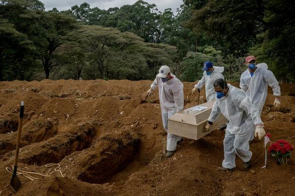 Burying a Covid-19 victim in São Paulo.