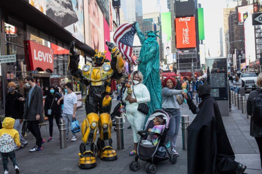 Visitors from Baltimore posing with characters in Times Square in May.